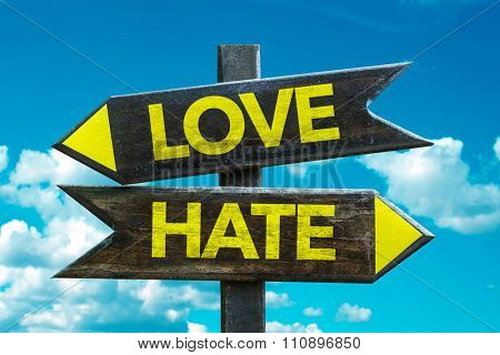Love - Hate signpost with sky background