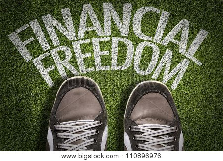 Top View of Sneakers on the grass with the text: Financial Freedom
