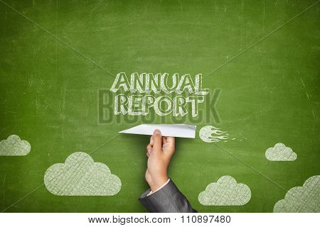 Annual report concept on blackboard with paper plane