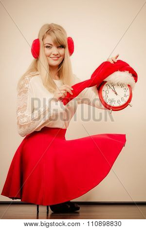 Happy Woman With Alarm Clock. Christmas Time.