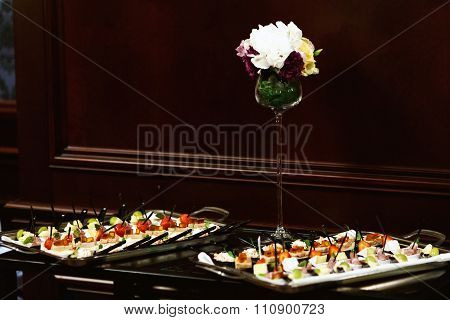 Set a variety of meat fish and fruit snacks on a table at a restaurant
