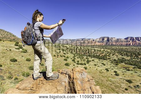 Woman Using a Map During a Hike