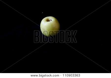 One Green Apple On A Black Background