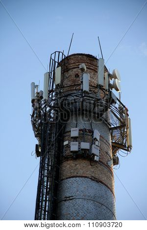 Radio signal transmitters on old smokestack
