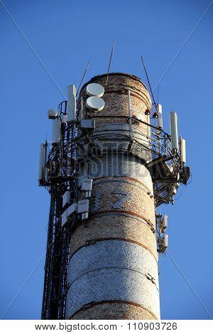 Radio signal transmitters on old smokestack