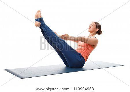 Beautiful sporty fit yogini woman practices yoga asana Paripurna navasana - boat pose isolated on white background