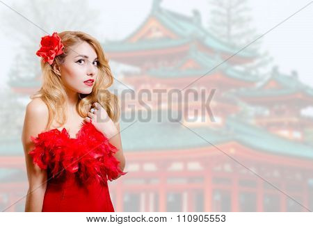Beautiful young lady in red dress on japanese pagoda background