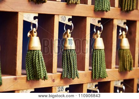 hotel keys with green tassels at reception desk counter