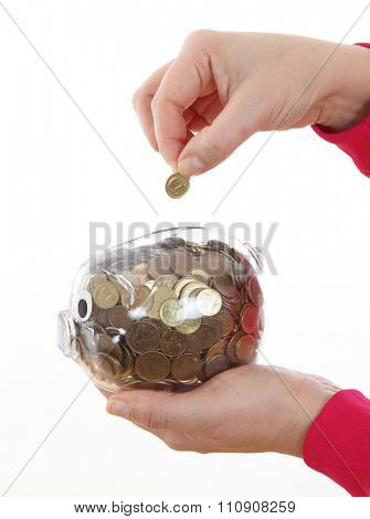 Woman hand saving coin in white piggy back on white background