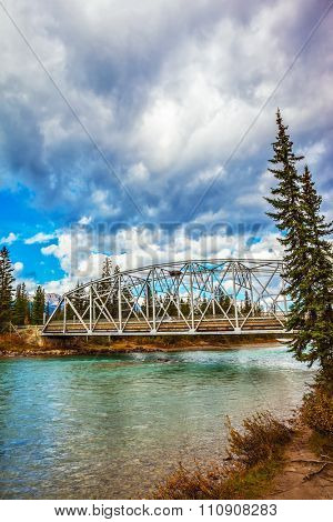 Road bridge over the picturesque river.  Canadian Rocky Mountains, Jasper National Park