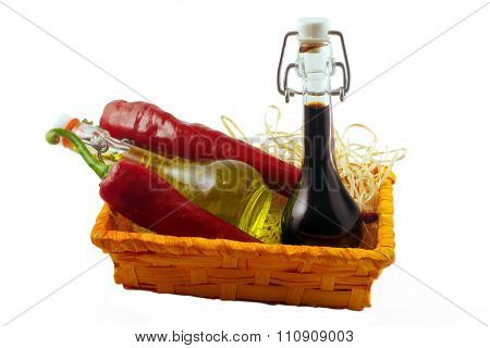 Two Bottles Of Wine Vinegar, Olive Oil And Two Red Hot Chilly Pepper