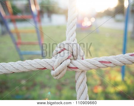 close up image of climbing net for childrens at the playground.it tied together securely.