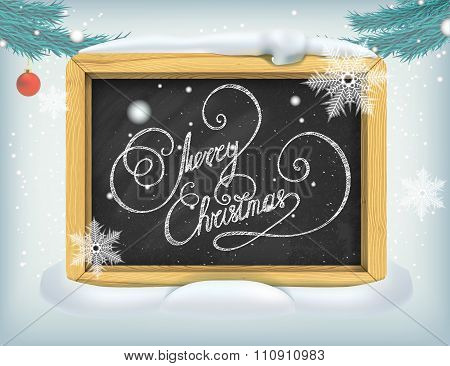 Merry Christmas lettering on blackboard