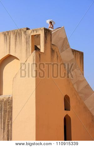 Jaipur, India - March 2: Unidentified Woman Stands On Top Of The Largest Sundial Of Jantar Mantar On