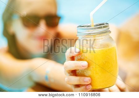 Fruit Smoothie - Healthy Eating Concept. Close Up Of  Detox Smoothie With Mango. Woman Hand With Gol
