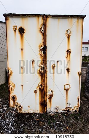 Old Metal Storage Shed With Rusty Side
