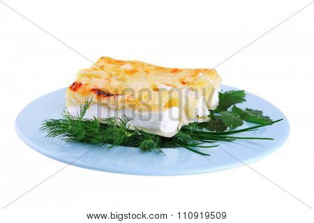 baked cannelloni with cheese served with greenery