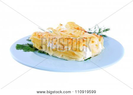 cheese cannelloni served with greenery on blue plate