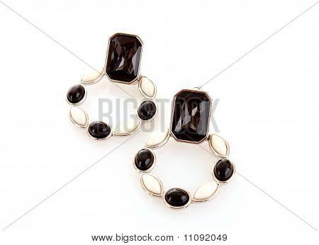 Golden Earring On Black Background