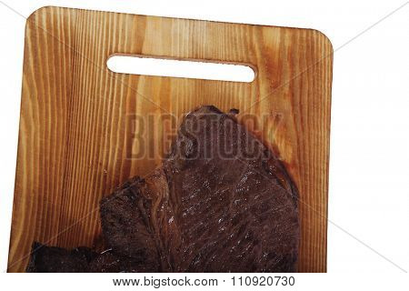 roast beefsteak fillet on wood isolated over white background