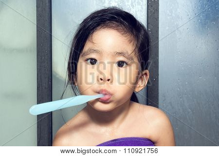 Funny Face Of Little Asian Girl Brushing Teeth