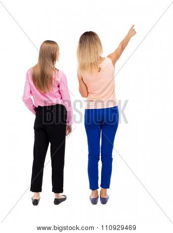 Back view of two pointing young girl. Rear view people collection.  backside view of person. Rear view. Isolated over white background. Two girls stand together looking at something interesting.