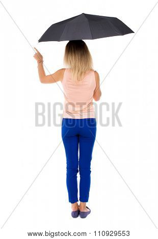 pointing  woman  under an umbrella. Rear view people collection.  backside view of person.  Isolated over white background. The girl under an umbrella stands and points at something interested.