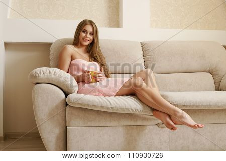 Lovely woman resting in living room after shower