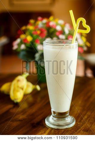 Banana Milk Shake On The Wooden Background