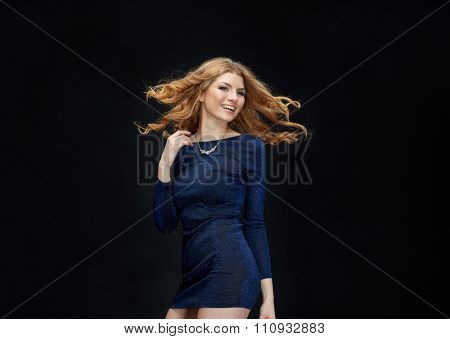 party, holidays, nightlife and people concept - happy young redhead woman dancing at night club disco over black background