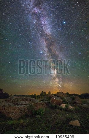 Bright Milky Way over the rocks