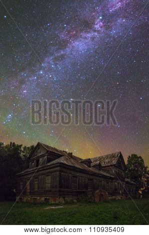 Old house under stars
