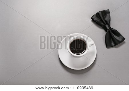 Cup Of Black Coffee With A Man Bow Tie
