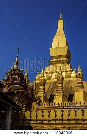 Golden Pagoda With Blue Sky At Wat Pha That Luang - Vientiane, Laos
