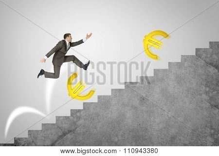 Man running up stairs with gold euro signs