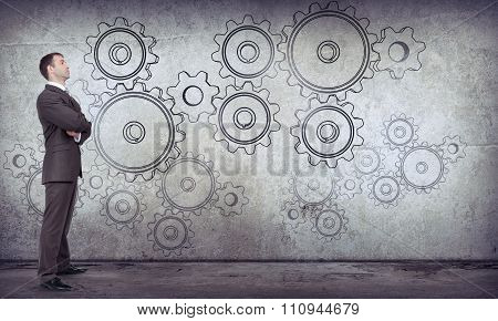 Businessman with cog wheels