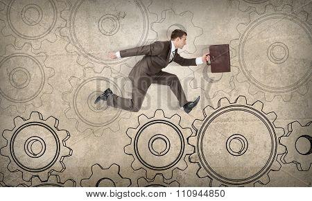 Man running on cog wheels