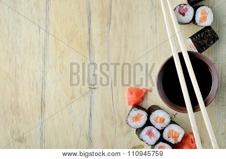 Sushi chopsticks over soy sauce bowl