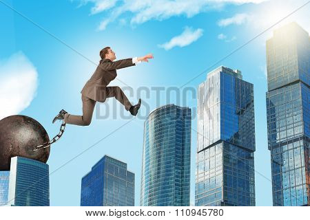Man with iron ballast hopping over town