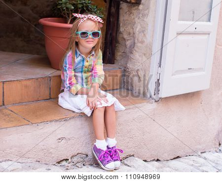 Adorable happy little girl outdoors in European city