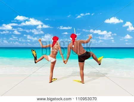 Positive Couple In Santa Hats Go Diving On Tropical Beach