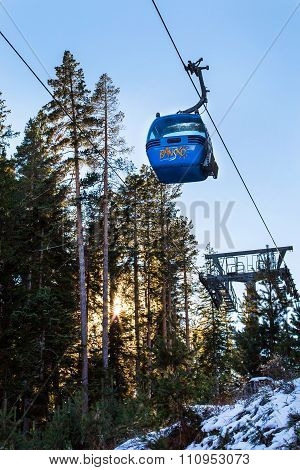 Close Up Bansko Cable Car Cabin, Pine Trees And Sun Against Blue Sky, Bulgaria