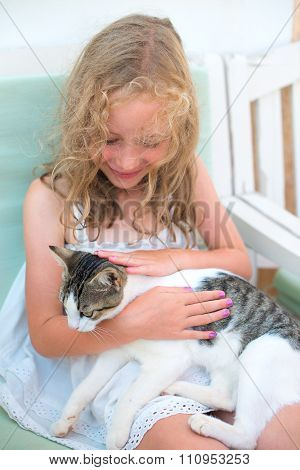 Cute Little Girl Playing With Cat.