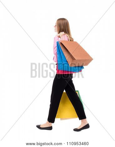 back view of going woman  with shopping bags. beautiful girl in motion.  backside view of person. Isolated over white background. woman is left businessman with lots of bags. throwing them on shoulder