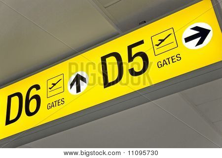 Yellow airport departure sign