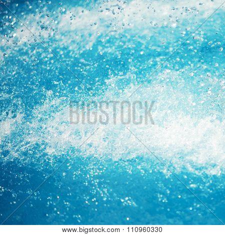 wave water splash background, spray of water. shower water drops.