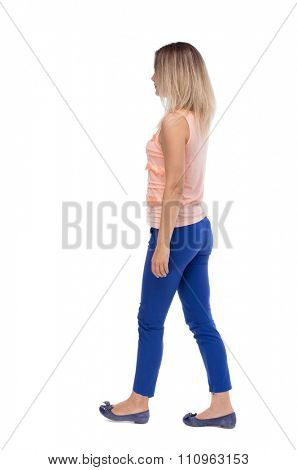 back view of walking  woman. beautiful blonde girl in motion.  backside view of person.  Rear view people collection. Isolated over white background. The blonde in a pink jacket goes away