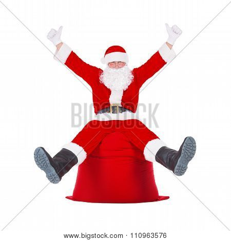 Santa Claus Hands Up Sitting On Big Christmas Presents Bag