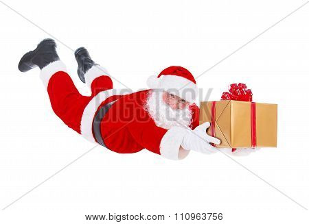 Santa Claus Flying With Christmas Gift Isolated On White Background