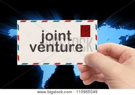 Hand Holding Envelope With Joint Venture Word And World Background